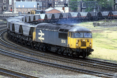 56114 rouns the curve at Holgate onto the York avoiding line with a rake of empty 'HAA' coal wagons (22/05/1987)