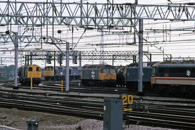 A long-range shot of 47365 'Diamond Jubilee' at Crewe Diesel Depot surrounded by a pair of 20s, a pair of 25s, 475xx and 87013 (16/05/1987)