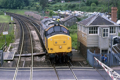 The view from the footbridge at Crediton as 37698 backs onto  1Z37 prior to taking the train north to Barnstaple (07/06/1987)