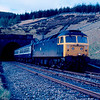 47543 exits the north portal of Blea Moor Tunnel with the 07:40 Hull - Carlisle 02/05/87