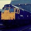 "Former Class 27 ADB 968025 which has been incorrectly numbered missing the ""9"". Stands on Eastfield Depot 07/02/87"