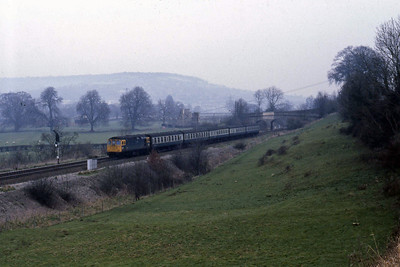 Having just joined the Great Western main line, 33021 accelerates away from the junction at Bathampton as it heads towards Bath with 1V46 0830 Brighton - Cardiff (22/02/1988)