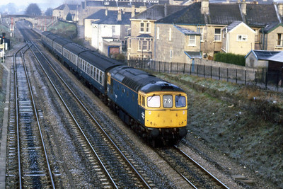 Having just had time to swap the telephoto lens for the standard 35mm version, here's another view of 33012 leaving Oldfield Park with 1O32 (22/02/1988)