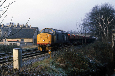37193 passes Oldfield park with a westbound train of coal wagons (22/02/1988)