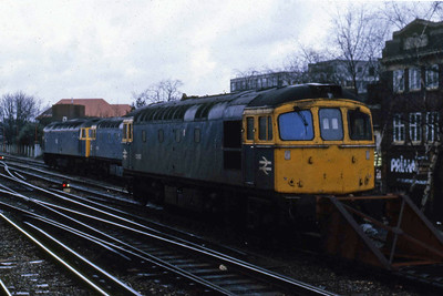 33002 is pictured in the sidings at the west end of Working station in the company of 33023 and an unidentified '47' (13/02/1988)