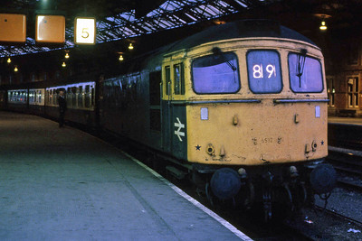 Having taken over the train from the incoming 33211, 33011 prepares to depart from Bristol Temple Meads on the last leg of the journey to Wales with 1V87 1810 Portsmouth - Cardiff (14/05/1988)