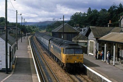 47518 arrives at Blair Atholl with 1Txx 1230 Inverness - Glasgow Queen Street (15/08/1988)