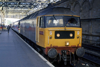 47016 'The Toleman Group' waits to depart from Edinburgh Waverley with 1M47 1744 to Birmingham New Street, which it worked as far as Carstairs (15/08/1988)