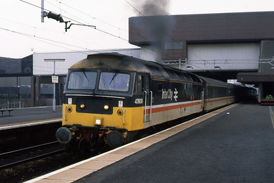 47609 'Fire Fly' departs Birmingham International with 1M14 1040 Poole-Liverpool (03/03/1989)