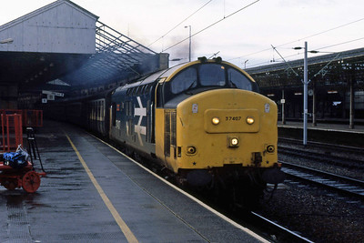 37407 'Loch Long' storms away from Crewe with 1M06 0507 Cardiff - Liverpool, a train which was temporarily booked for loco-haulage due to an ongoing shortage of 'Sprinters' (04/03/1989)