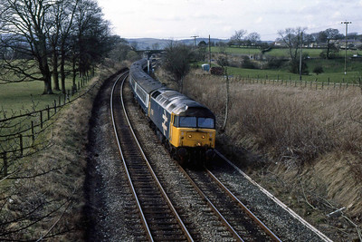 Easter Weekend saw the traditional closure of the WCML between Preston and Carlisle, with services diverted over the 'S&C'. 47459 passes through Long Preston with the retimed 1V59 1009 Glasgow Central - Plymouth (25/03/1989)