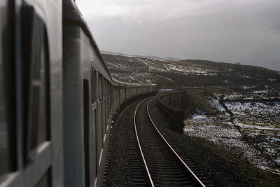 A sprinling of snow covers the fells as 58036 + 47456 cross Dandry Mire viaduct on the approach to Garsdale with 1E11 (03/03/1990)