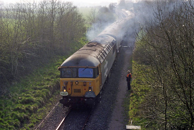 With the East Somerset Railway's station just visible through the smoke from the engine, 56041 shunts the stock for the returning 'Mendip Quarryman' charter back into the platform at Cranmore (17/03/1990)