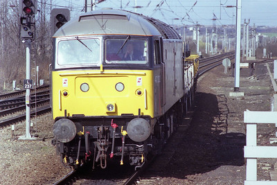 Departmental grey liveried 47332 cruises through Wakefield Westgate with a short train bound for the electrification depot at Doncaster (11/03/1989)