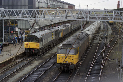 A busy scene at Carlisle sees 58036 + 47456 in Platform 1 shortly after arriving with 1M09 from Leeds. In the foreground is 47426 with the Clitheroe to Newcastle cement tanks (03/03/1990)