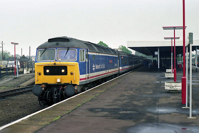 47596 'Aldeburgh Festival' arrives at Ely with 1H55 0800 Kings Lynn-Liverpool Street on the last day of loco-hauled services on the route (12/05/1990)