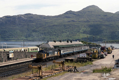 The classic view of Kyle of Localsh, with the Isle of Skye in the background. 37421 awaits departure time with 2H84 1530 to Inverness (13/7/1990)