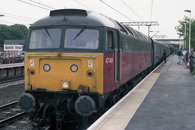 Recently repainted into the new 'Parcels Sector' livery and named 'Crewe Diesel Depot', 47489 calls at Wakefield Westgate with 1E95 0924 Yarmouth-Leeds (21/07/1990)