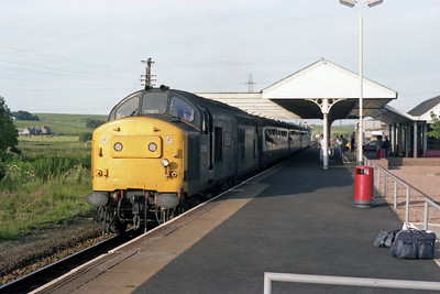 37156 'Brisitsh Steel Hunterston' arrives at Keith with 1H37 1805 Aberdeen - Inverness (13/07/1990)