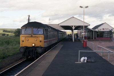 47595 'Confederation of British Industry' is pictured arriving at Keith with the 1805 Aberdeen-Inverness (11/07/1990)