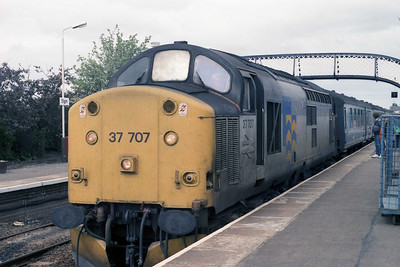 Petroleum Sector 37707 is pictured on arrival at Elgin with 1A62 0915 ex-Inverness (12/07/1990)