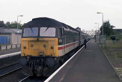 47550 'University of Dundee' is pictured on arrival at Dyce with 2A68 1638 from Aberdeen - at 6.25 miles, surely one of the shortest-distance loco-hauled services on the network (12/07/1990)