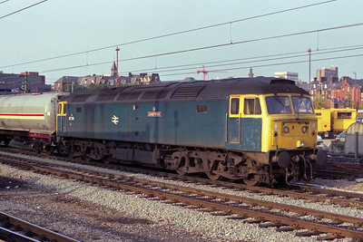 Tinsley's 47219 'Sandpiper' waits at Preston with a southbound train of oil tanks (11/09/1990)