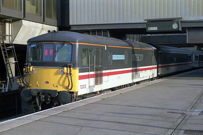 73202 'The Royal Observer Corps' catches the early morning sunshine at Gatwick Airport after arriving with the 0715 from London Victoria (02/09/1990)