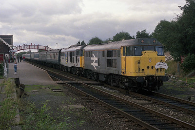 31210 + 31201 stand at Appleby with the 1635 Carlisle - Cleethorpes return charter for Crowle Community Hall (09/09/1990)
