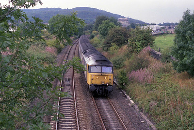 47434 'Pride in Huddersfield' heads south from Bingley at Dowley Gap with 2E24 1243 Carlisle - Leeds (05/09/1990)