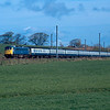 85026 passes Oubeck south or Lancaster working the 07:45 Carlisle - London Euston relief train 27/04/90