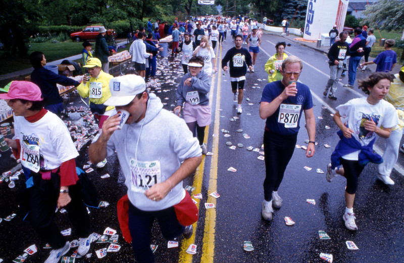A group of runners gets refreshment during the 1992 Bolder Boulder.