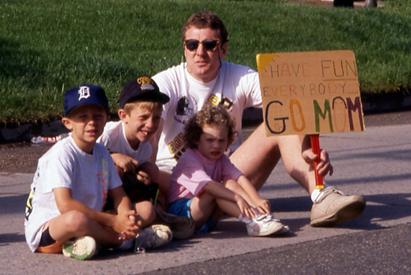 A family waits for mom to pass by in the 1991 Bolder Boulder.