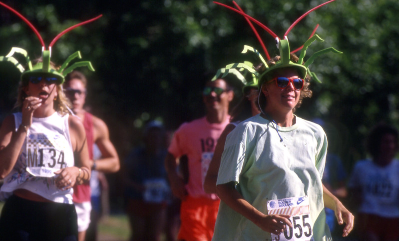 Runners wearing costume hats run in the 1990 Bolder Boulder.