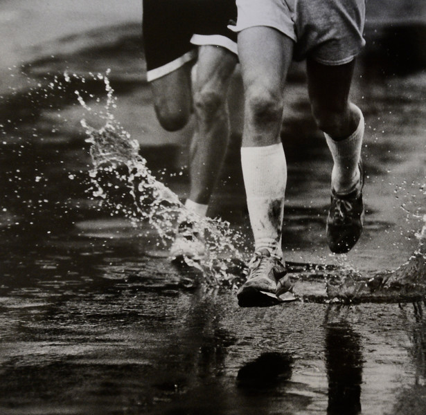 Runners run through the puddles in the 1995 Bolder Boulder.