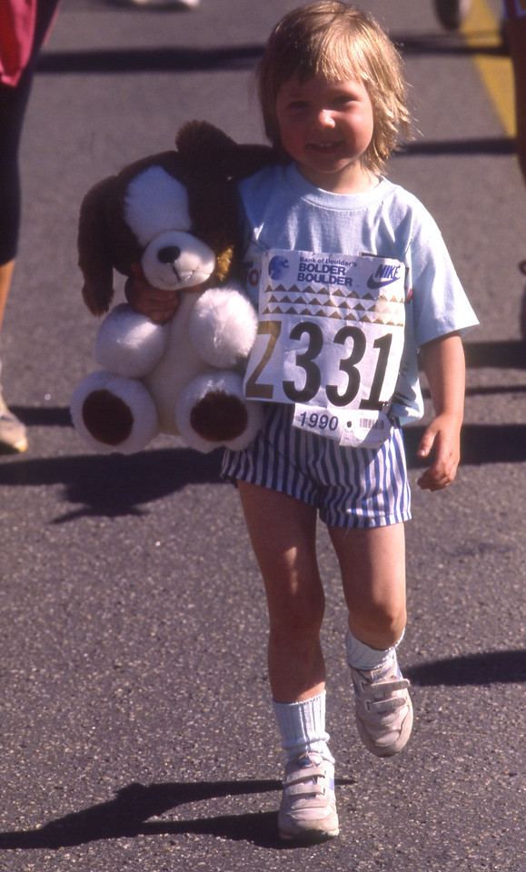 A little girl and her doll in the 1990 Bolder Boulder.
