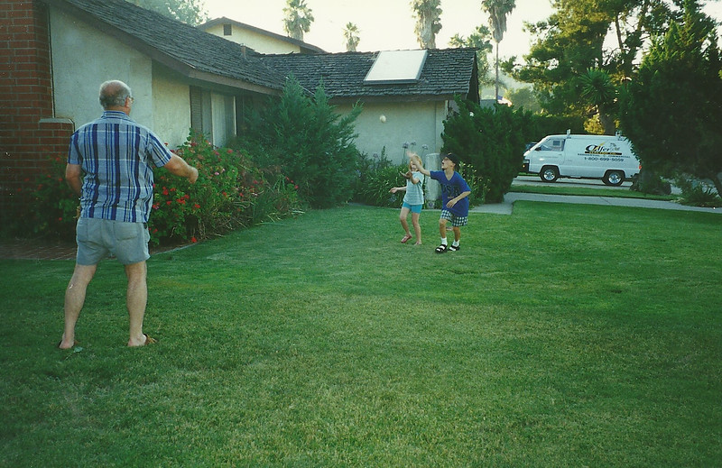 Grandpa playing ball with the kids