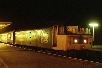 Sprting AZ's 'Cumbian Sulzer Farewell' headboard, 47635 waits to depart from Barrow later that evening with 2N42 1959 to Preston (19/01/1991)