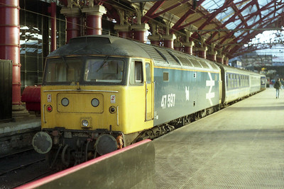 It's that 'Wandering Dog' again... 47597 is pictured on the blocks at Liverpool Lime Street after arriving with 1M15 0730 ex-Newcastle (19/01/1991)