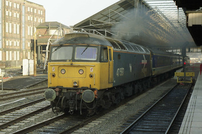 Another former Scottish region machine - 47597 - storms away from Huddersfield with 1M94 0816 Newcastle-Liverpool (04/01/1991)