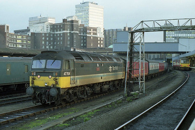47704 'Dunedin' shunts empty vans in the PCD at Leeds. Although it was now a Crewe-based Parcels sector machine (and was perfoming its normal duties), the former 'shove' looks decidedly out of place (04/01/1991)