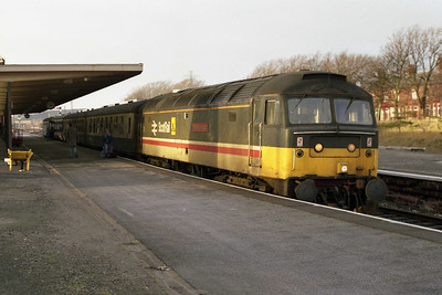 Having run round, 47492 catches a brief patch of winter sunlight as it waits to head back from Barrow with 2J90 1542 to Manchester Victoria (19/01/1991)