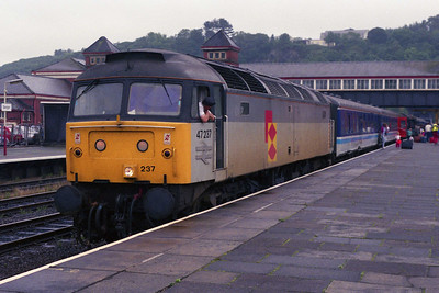 47237 is pictured during the now customary Bangor 'phoyo stop' with 2D67 1052 Manchester Victoria-Holyhead (10/08/1991)