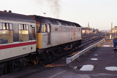 Deputising for the booked 'HST' 47605 powers away from the station towards the former Swindon Works complex with 1C08 (04/11/1991)