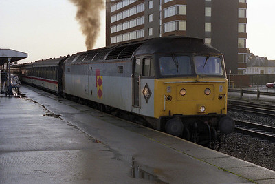 Still carrying Railfreight Distribution colours from its spell at Tinsley, Parcels Sector 47605 departs from Swindon with 1C08 0645 Paddington-Bristol Temple Meads (04/11/1991)