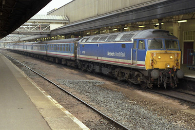 The next morning 47709 waits to depart from Exeter St Davids with the SuO 1O35 0928 to London Waterloo (10/11/1991)