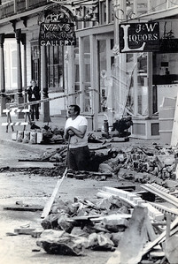 A worker in Ferndale clears rubble from Main Street following the Cape Mendocino quakes in April 1992. (Photo by The Associated Press)