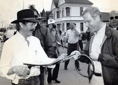 Sculptor Hobart Brown gives then California Gov. Pete Wilson a key to the city that was specially made by Hobart for Wilson's visit. It was made of copper tubing and braised brass. The key is bent intentionally because of the quakes. Wilson reportedly carried it around as he toured quake damage in 1992. (Photo by The Associated Press)