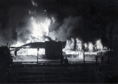 Firefighters work on a blaze at the Scotia Shopping Center that was part of damages in Scotia estimated to be $15 million, according to Times-Standard reporting from April 27, 1992. (Times-Standard file photo)