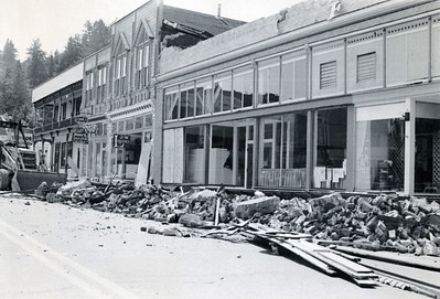 A tractor moves to pick up debris along Main Street in Ferndale after the April 1992 quakes destroyed much of the area. (Photo by The Associated Press)